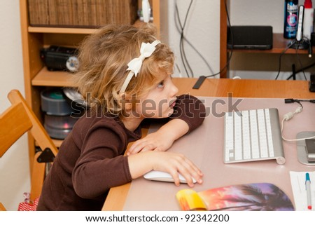 Playing online games on home desktop computer. - stock photo