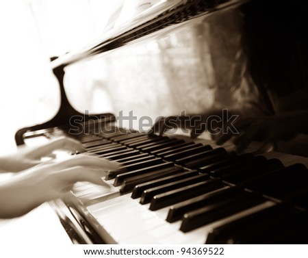 Playing piano - stock photo