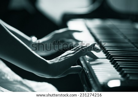 Playing piano close up hands - stock photo