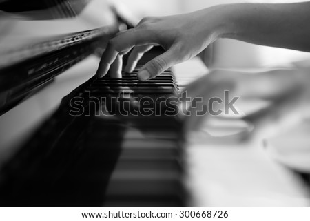 Playing Piano in Black and White Tone (Soft Focus) - stock photo