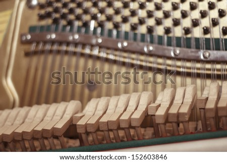 Playing piano strings and hammers close up