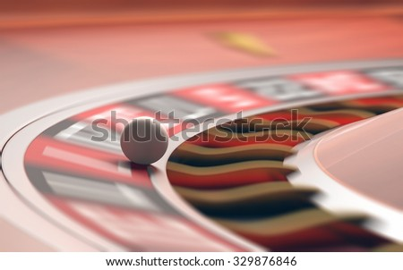 Playing roulette in the casino. Motion blur on the wheel and numbers. Depth of field with focus on the ball. - stock photo