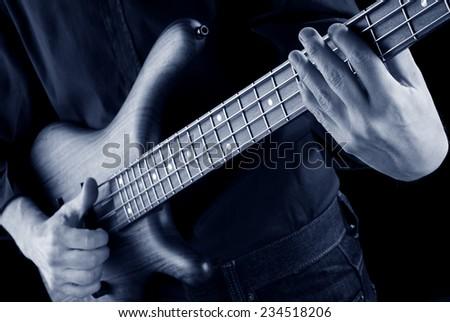 playing slap bass, blue image - stock photo