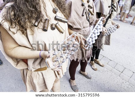 Playing tambourines in the city, detail of musicians playing in the street - stock photo