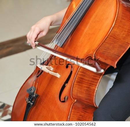 Playing the cello at opera - stock photo