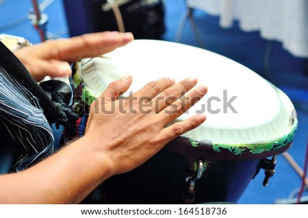 Playing the drum. Focus on the hand and other hand in motion - stock photo