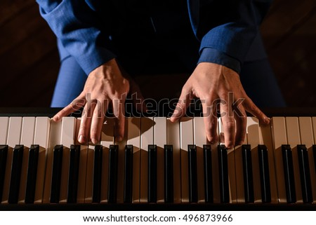 Playing the piano, the pianist plays