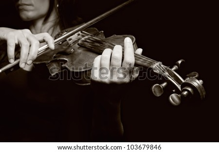 Playing the violin. Musical instrument with performer hands. Black and white photo