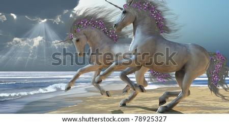 PLAYING UNICORNS Part 2 - Two beautiful white unicorns frolic on the beach. - stock photo