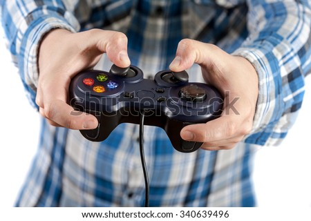 Playing video games is fun. Isolated on white background. - stock photo