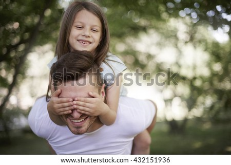 Playing with daddy on fresh air  - stock photo