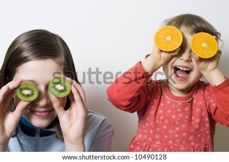 Playing with fruits, healthy nutrition - stock photo