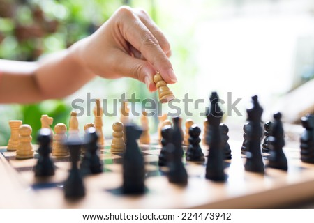 Playing wooden chess - stock photo