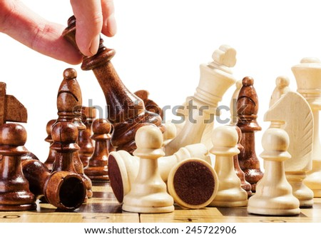 playing wooden chess on chess board - stock photo