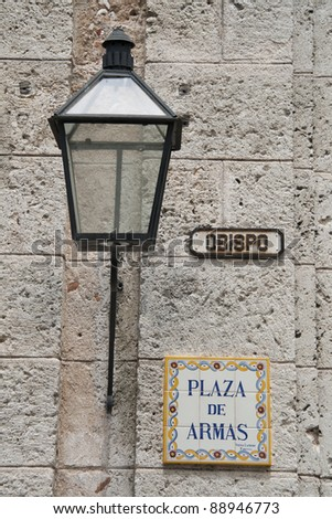 Plaza de Armas street sign and lantern in Havana