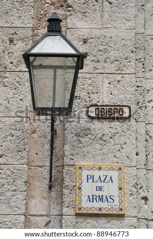 Plaza de Armas street sign and lantern in Havana - stock photo