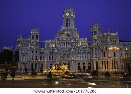 Plaza de Cibeles in Madrid, Spain at night. With Cibeles Fountain and the Royal Mail office in the background (Palacio de Comunicaciones or Correos)