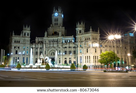 Plaza de Cibeles in Madrid, Spain at night. With Cibeles Fountain and the Royal Mail office in the background (Palacio de Comunicaciones or Correos). - stock photo