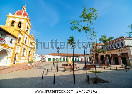 Plaza in Mompox, Colombia with a cathedral and old abandoned market - stock photo