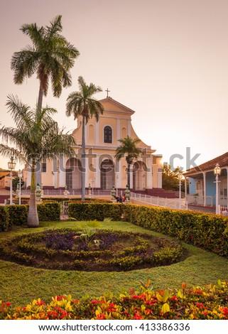 Plaza Mayor and the Church of the Holy Trinity at sunrise, Trinidad, Cuba - stock photo