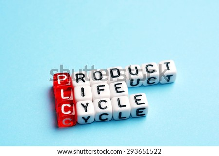 PLC Product Life Cycle written on dices on blue background - stock photo