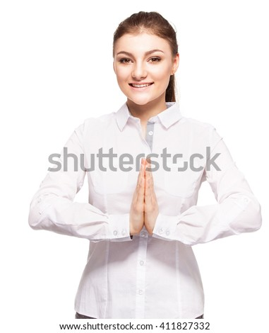 Pleading young woman. Woman with folded hands isolated on white - stock photo