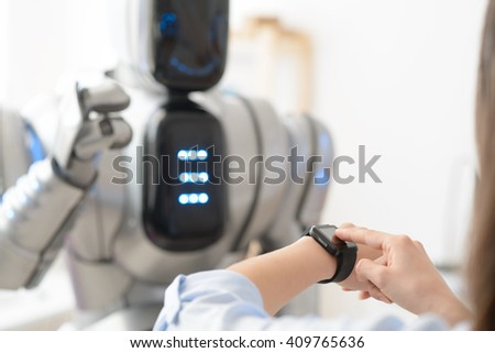 Pleasant girl  using smart watch  - stock photo