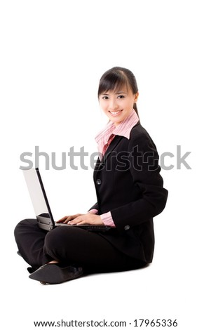 pleasant looking asian business woman sitting with a laptop