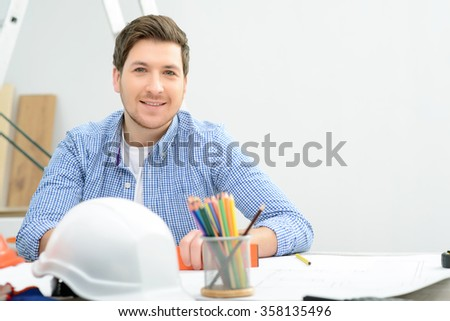 Pleasant man making drawing  - stock photo