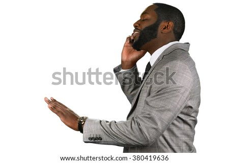 Pleasant news. Afroamerican manager giving instructions. Optimistic chief on the phone. No need to worry. - stock photo