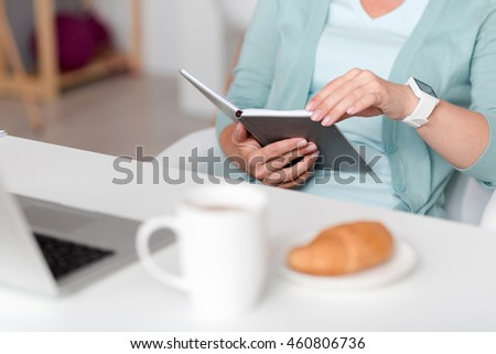 Pleasant woman holding her note book