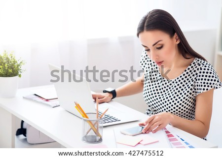 Pleasant woman sitting at the table