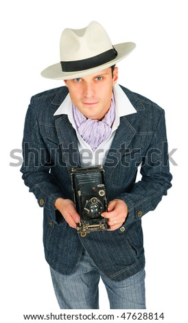 pleasant young man in a hat with a camera