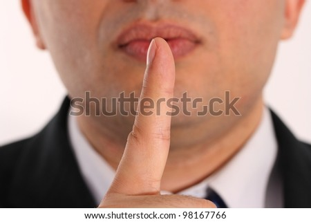 please be silence, hand and mouth expressions of a businessman - stock photo