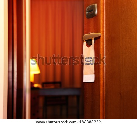 Please do not disturb sign hanging on open door in a hotel - stock photo