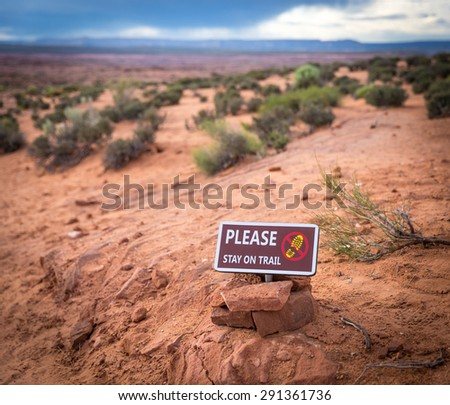 Please stay on trail Sign Warning that Hikers should stay on The Trail for Their Protection - stock photo