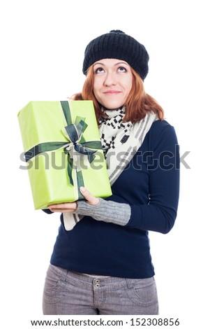 Pleased winter woman holding present, isolated on white background. - stock photo