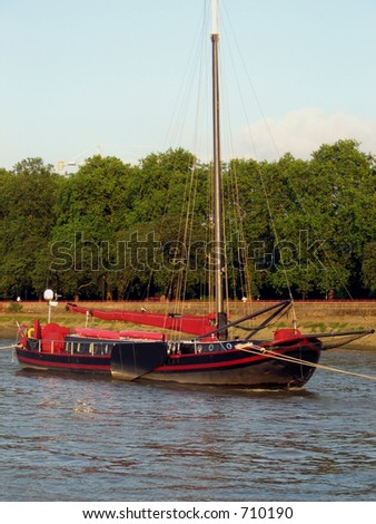 Pleasure boat trip from Kew to Westminster River Thames, London.  Sailboat at Rest - stock photo