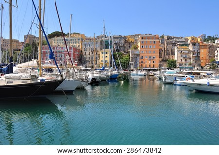 pleasure boats in the port of Bastia with its colorful buildings - Corsica - stock photo