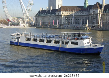 Pleasure cruiser on the River Thames in London, England - stock photo