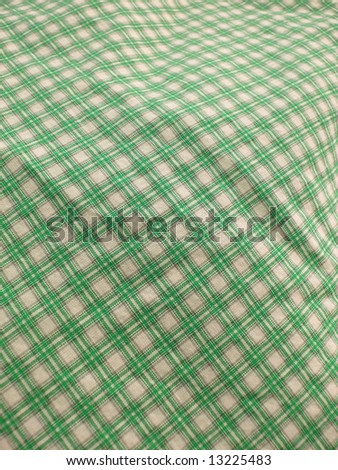 Pleated checkered fabric closeup - series - green. Good for background. More fabrics in my port. - stock photo