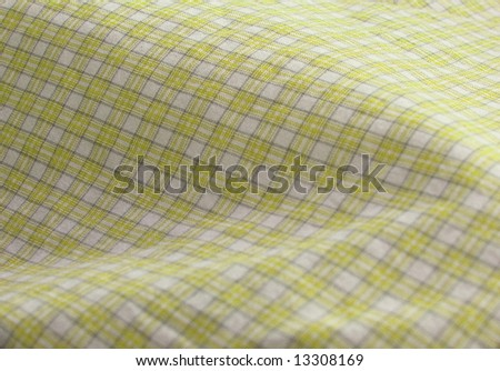 Pleated checkered fabric closeup - series - yellow. Good for background. More fabrics in my port. - stock photo