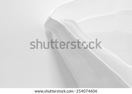 pleated white damask table napkin