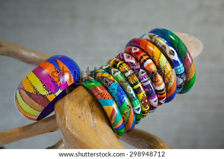 Plenty of colorful bracelets made of wood. Hand-painted in the style of Latin America - stock photo