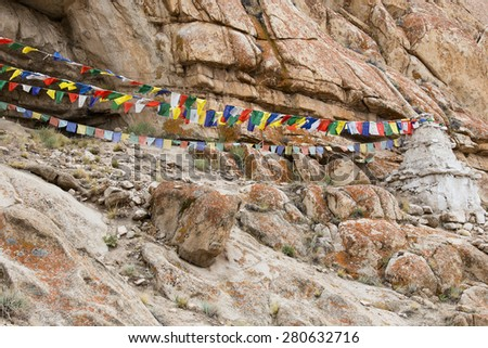 Plenty of colorful Buddhist prayer flags on the Stupa near Takthok gompa, Buddhist monastery in Ladakh, Jammu Kashmir, India - stock photo