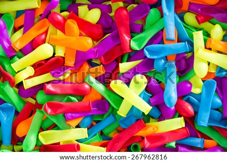 Plenty of Colorful Deflated Water Balloons for Summer Fun, Captured in High Angle View. Can be Used for Wallpaper Backgrounds. - stock photo