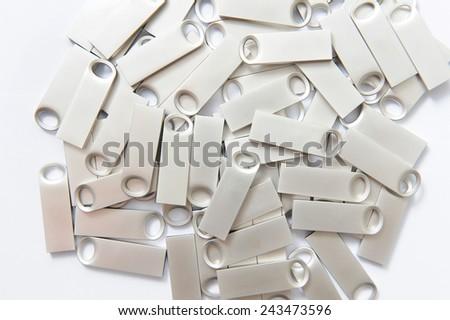plenty of metal usb sticks on white - stock photo