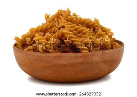 plenty of raw pasta in bowl on white background   - stock photo