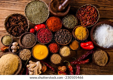 Plenty of traditional Asian spices in wooden bowls - stock photo