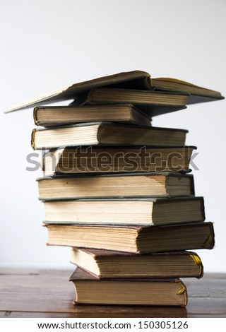 Plie of old books - stock photo